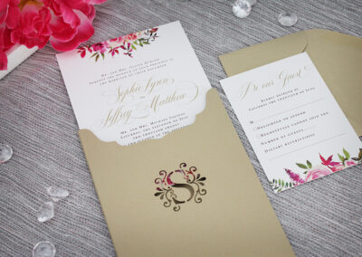 Wedding invitation with monogram cutout sleeve